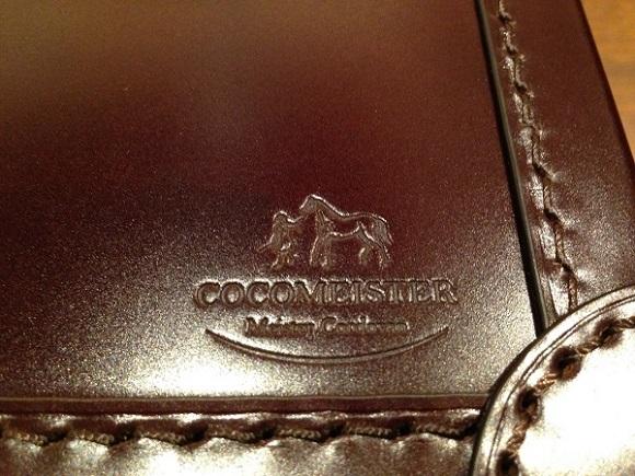 ココマイスターのビジネスバッグ・アタッシュケース「マイスターコードバンサンシモン」のロゴ