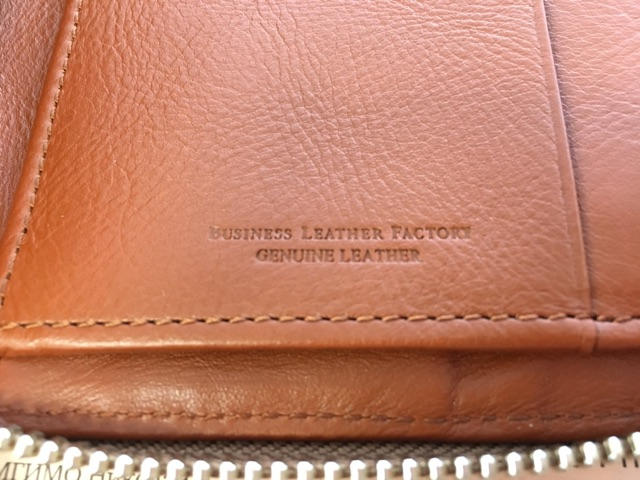 Business Leather Factoryの長財布(ラウンドファスナー)のロゴ